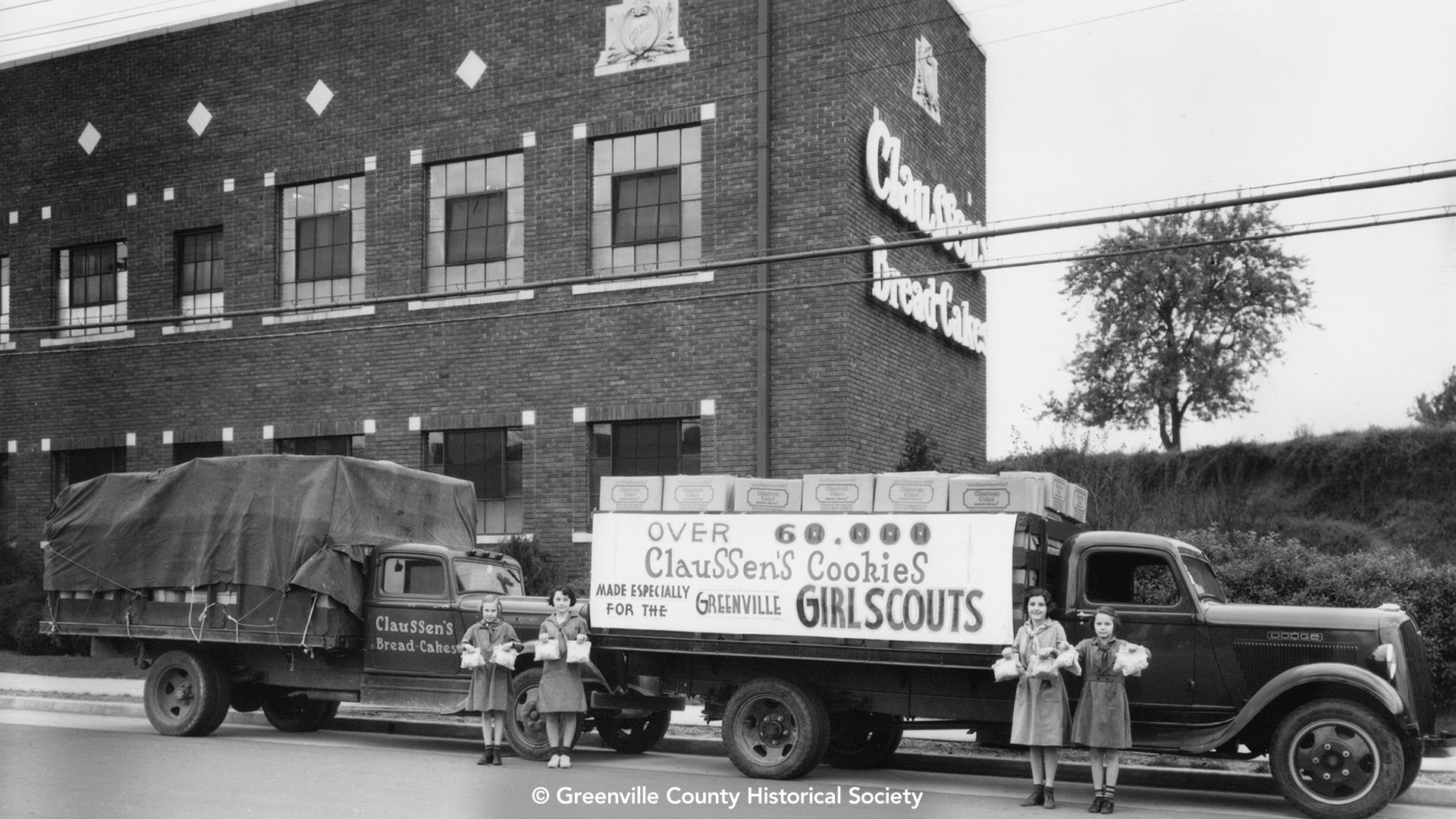 Historic photo of Girl Scouts selling cookies outside Claussen's Bakery